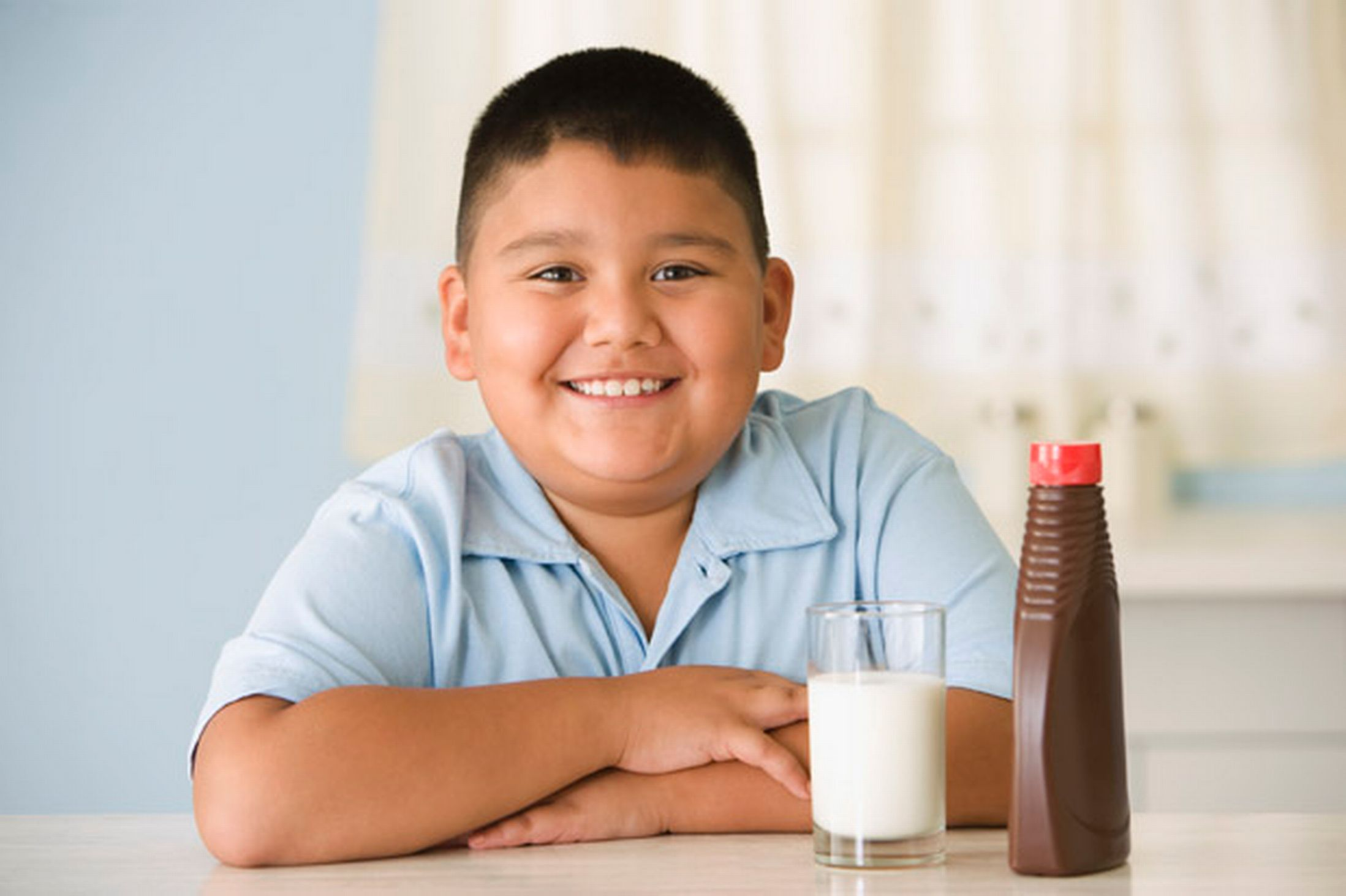 Closeup portrait of a smiling overweight boy